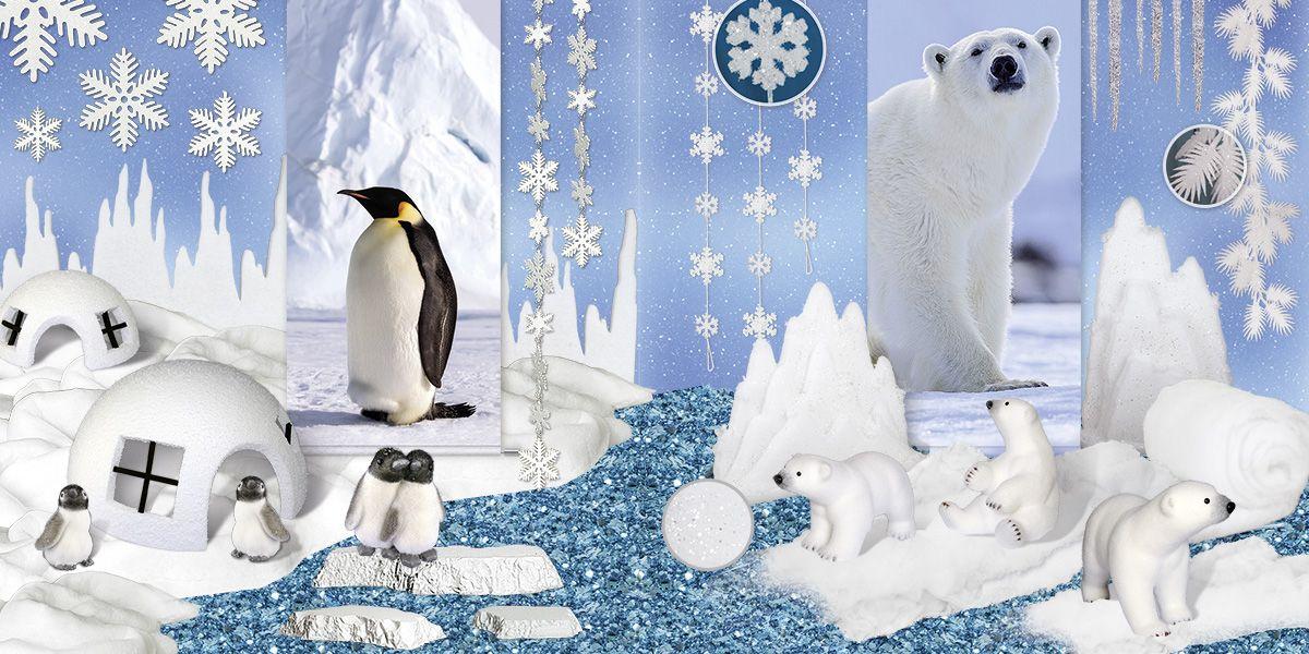 Winterliche Dekoration mit Kunstschnee Pinguinfiguren, Eisschollen und Polarbären